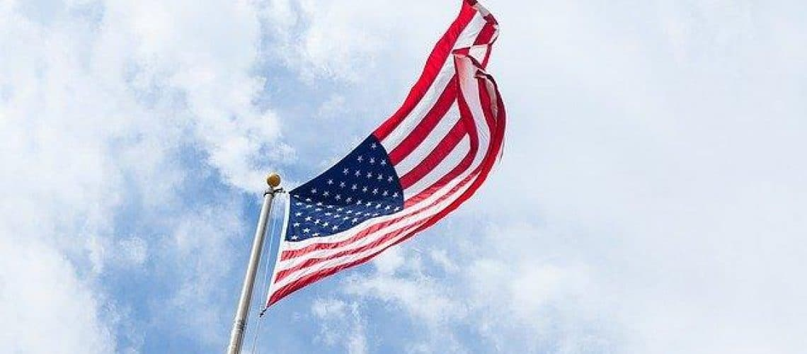 American Flag blowing in the wind looking at the sky