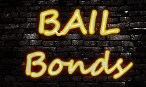 Neon Bail Bond sign on a brick wall