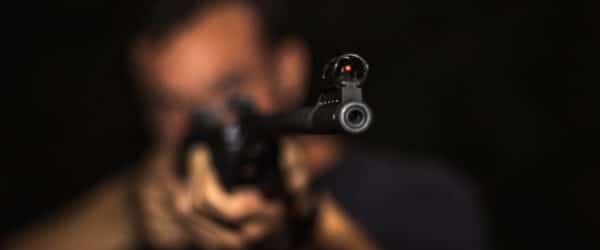 Blur person pointing a gun