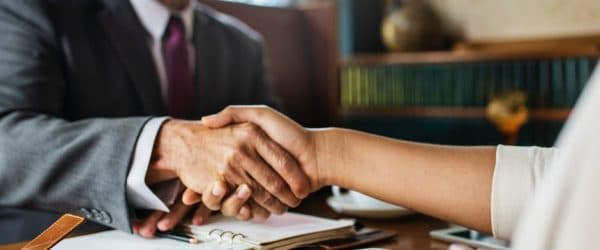 Lawyer shaking hand of client
