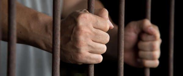 Hands of the prisoner in jail