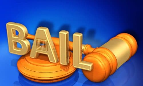 the word bail with a court gavel in gold and 3d